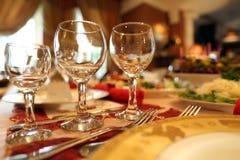 Buffet restaurant cafe hall glass tableware celebration Royalty Free Stock Image