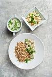 Buffet restaurant, menu option, beef Stroganoff, green salad and chicken soup. Gray background, top vie stock photography