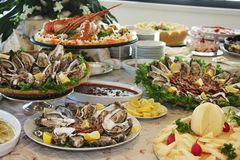 Huge buffet in restaurant with oysters, lobsters and cheese stock image