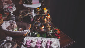 Buffet served a variety of desserts, cupcakes and Royalty Free Stock Photo