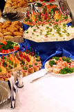 Buffet with snacks at presentation #2. Buffet with snacks on tables at presentation Royalty Free Stock Images