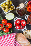 Buffet style authentic spanish tapas on table with fresh herbs Royalty Free Stock Photos