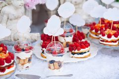 Buffet with sweets. Cakes with raspberries. Sweet table for banquets, weddings, parties royalty free stock photography