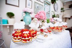 Buffet with sweets. Cakes with raspberries. Sweet table for banquets, weddings, parties stock photo