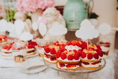 Buffet with sweets. Cakes with raspberries. Sweet table for banquets, weddings, parties stock images
