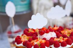 Buffet with sweets. Cakes with raspberries. Sweet table for banquets, weddings, parties royalty free stock photo