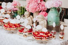 Buffet with sweets. Cakes with raspberries. Sweet table for banquets, weddings, parties. Candy bar royalty free stock images
