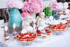Buffet with sweets. Cakes with raspberries. Sweet table for banquets, weddings, parties. Candy bar royalty free stock photo