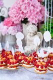 Buffet with sweets. Cakes with raspberries. Sweet table for banquets, weddings, parties. Candy bar stock images