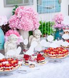 Buffet with sweets. Cakes with raspberries. Sweet table for banquets, weddings, parties stock photography