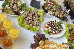 Buffet table. Table with drinks and sandwiches covered for a buffet table Stock Photo
