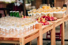 Buffet table. Alcoholic drinks in glasses and snacks on a buffet table Stock Photography