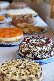 Buffet table with an assortment of cakes Stock Photos