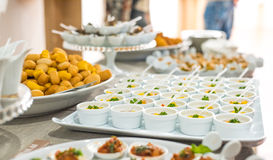 A buffet table with different type of food servings Royalty Free Stock Photography