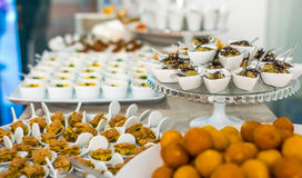 A buffet table with different type of food servings Royalty Free Stock Photos