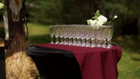 Buffet table with empty champagne glasses. Standing in the street. stock video footage