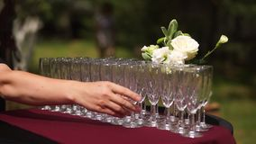Buffet table with empty champagne glasses. Standing in the street. stock video