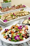 Buffet Table Food. Buffet table with trays of cheese and tomato salad and sliced meat Stock Photos