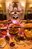 Buffet table with ice sculpture in restaurant at wedding day celebration Royalty Free Stock Images