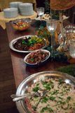 Buffet table at a luxury event. Spread with a variety of cold meat platters Stock Image