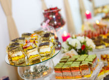 Buffet table with pastries, sweet cream, strawberry and dessert Stock Photography