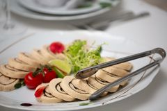 Buffet table of reception with cold snacks, meat and cherry tomato stock photo