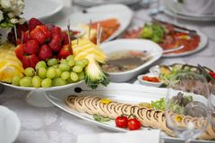 Buffet table of reception with cold snacks, meat, salads stock image