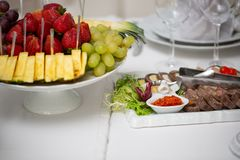 Buffet table of reception with cold snacks, meat, salads stock photo