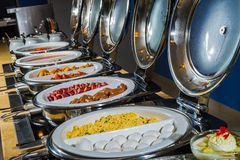 Buffet Table. With Row of Food Service Steam Pans Stock Images