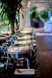 Buffet Table with Row of Food Service Steam Pans Stock Photo