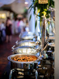 Buffet Table with Row of Food Service Steam Pans Royalty Free Stock Photo