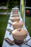 Buffet Table with Row of Food Service Steam Pans Stock Photography