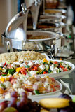Buffet table with salads and fruits Royalty Free Stock Photo
