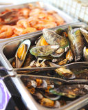 Buffet table with seafood with shrimps, fried calamari rings and Royalty Free Stock Photos