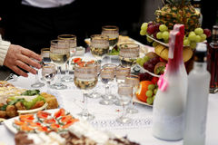 The buffet table with snacks and alcohol are near house Royalty Free Stock Photography