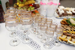 The buffet table with snacks and alcohol are near house.  stock images