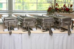 Buffet Warmers. Buffet Table With Stainless Steel Food Warmers stock photos