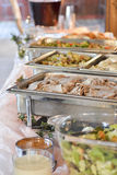 Buffet with Trays of Food at an Event Royalty Free Stock Images