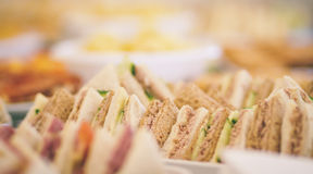 Buffet - tuna sandwiches. Buffet table showing tuna and cucumber sandwiches Royalty Free Stock Photography