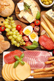 Buffet of various types of cheese and appetizers set Stock Photo