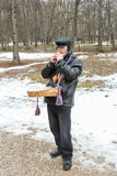 Buffoon playing the penny whistle. Holiday Carnival in general Vitoslavlitsy near Novgorod royalty free stock image
