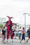 Buffoon on stilts during Stockholm Pride Parade. STOCKHOLM, SWEDEN – JULY 30, 2016: Buffoon on stilts during Stockholm Pride Parade on Hantverkargatan stock photo