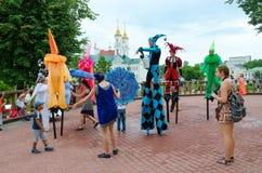 Buffoons on stilts near puppet theater, Vitebsk, Belarus Royalty Free Stock Photos