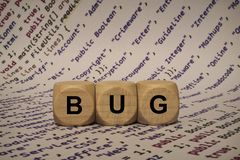 Bug - cube with letters and words from the computer, software, internet categories, wooden cubes Royalty Free Stock Image