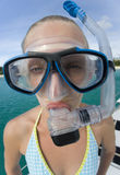 Bug-eyed snorkeler. Funny bug-eyed teenage girl in a snorkel mask.  On vacation in Fiji in the South Pacific Royalty Free Stock Photography