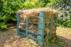 Bug Hotel. Made out of old pallets, hay, and earthenware for all the creepy crawlies to have somewhere to live. taken in a stately home garden stock photography