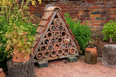 Bug or Insect House. A bug or insect house showing ceramic tubes filled with material ti encourage insects to breed royalty free stock photography