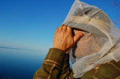 Bug Net. A man wearing a bug net to keep off biting insects Royalty Free Stock Photos