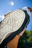 Bug's perspective. Woman walking outdoors stepping on insect. Under the shoe perspective Stock Image