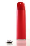 Bug Spray. Blurred, dead bug in front of a tall, red  can of bug spray Royalty Free Stock Photos